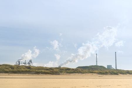 Dutch steel industry in Wijk aan Zee at the coast Stockfoto - 95257435
