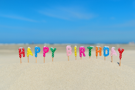 Happy birthday candles at the beach