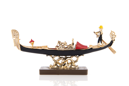 Golden Venetian boat as souvenir isolated over white background Banque d'images