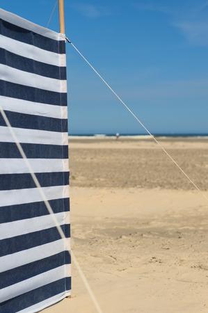 Striped wind break at the beach