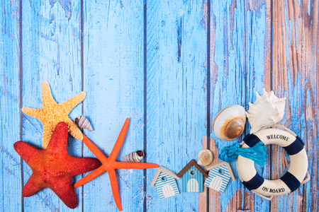 Beach poster on wooden background with starfishes and cabins