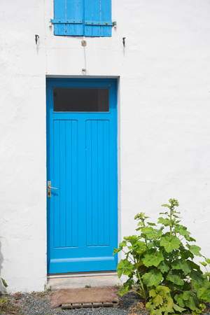 Blue wooden door in France Stock Photo