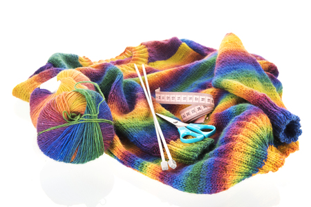 Colorful knitted jumper with needles and wool isolated over white Imagens - 112062240