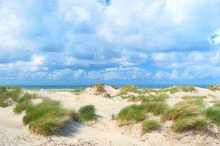 Landscape dunes at empty beach at Dutch island Terschelling