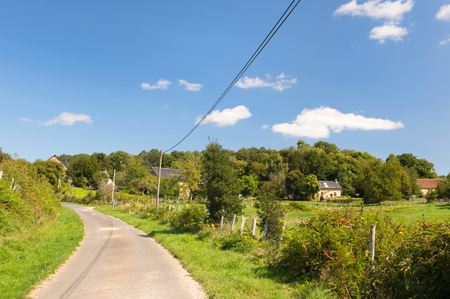 Typical romantic landscape with little lane and farm houses 版權商用圖片