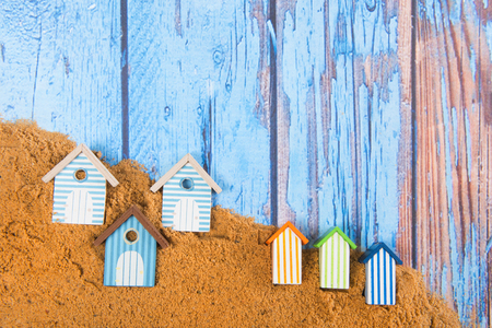 Beach huts in sand at the beach Imagens