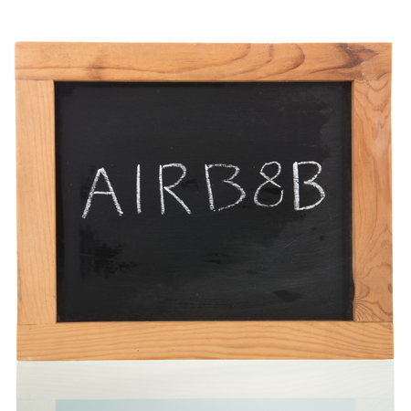 Airbnb written on blackboard isolated over white
