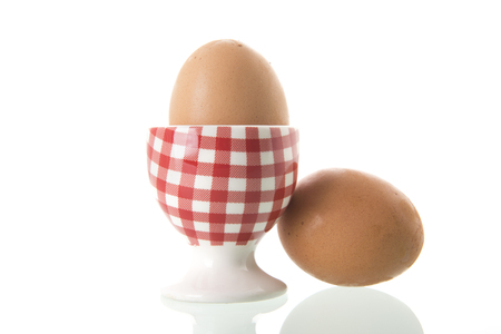 Chicken egg in red and white checkered cup