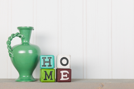 Green vintage vase in interior at home Stockfoto