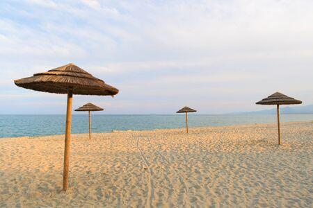 Landscape on island Corsica with wicker parasols 版權商用圖片
