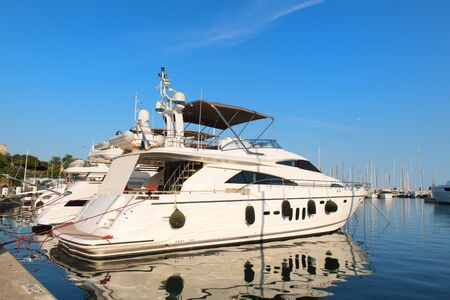 Luxury yacht at pier in harbour