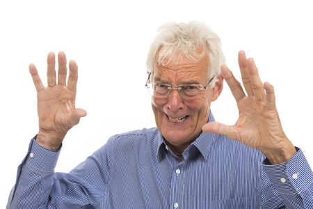 Portrait scaring senior man isolated against white background