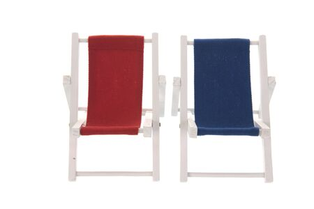 Empty beach chairs in red and blue