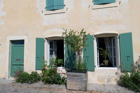House with green shutters on French island Ile de Re