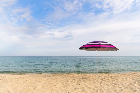 Vacation with shade with umbrella at the beach