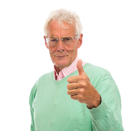 Senior man in green sweater thumbs up isolated over white background
