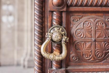 doorknocker: Door knocker  Door handle  on a old wooden door