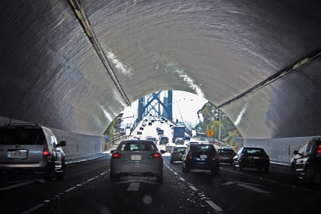 View from a tunnel to a road photo