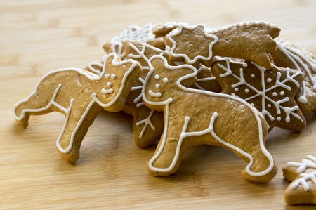 shaped: Painted light brown traditional czech ginger breads, white icing, Christmas cookies, shapes - snowflakes, stars, two teddy bears,