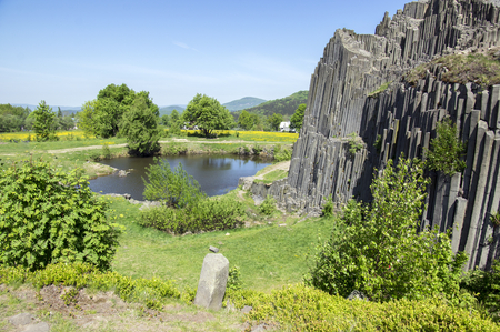 National Natural Monument named Panska skala, columnar jointed basalt rock in Kamenicky senov village in Czech republic, tourist attraction, sunny day and blue sky