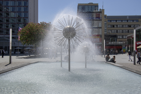 Dresden  Germany - May 7, 2018: Dandelion fountains are refreshing town visitors on Prager Strasse during hot day.