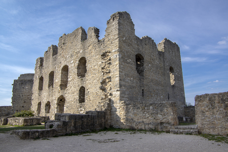 Burgruine Wolfstein old historic castle ruins with tower, blue sky and sunlight