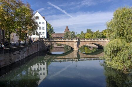Nuremberg / GERMANY - September 17, 2018: Maxbrucke one of the most picturesque part of Nuremberg, sunny day and blue sky.