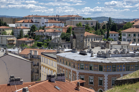 Amazing aerial view to Italian Trieste city. Group of buildings view from fortress. Beautiful sunny day. Banco de Imagens