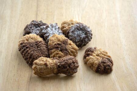 Cinnamon sandbakelse christmas cookies, two color, cocoa dark brown and vanilla light golden brown, delicious czech cookies