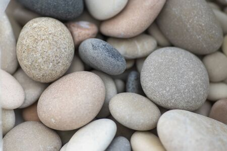 White, gray and pink pebbles simple background, simplicity group of stones one by one