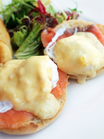 Closeup of breakfast, egg benedicts with salmon     photo