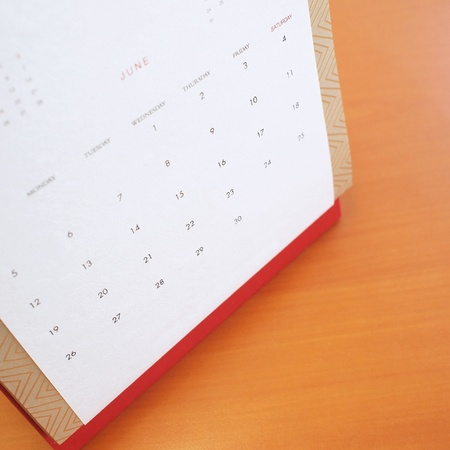 A desktop calendar at the page of June 2011  photo