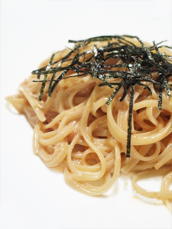 Closeup of Japanese style linguine in white sauce with marinated pollock roe (mentaiko) photo