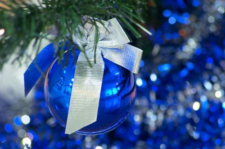 bough: Blue christmas ball with silver ribbon Stock Photo