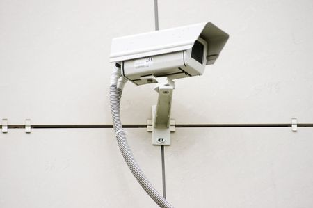 Security camera at the office wall photo