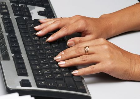 Hads with manicure and computer keyboard Stock Photo - 498268