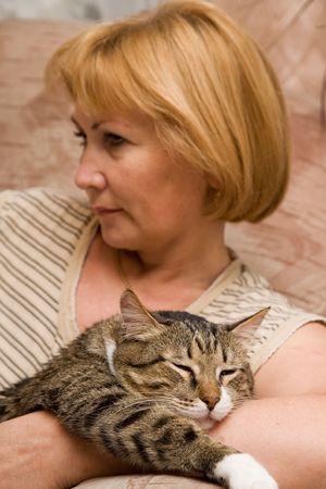 Woman with sleeping gladful cat. Kuzia - senior cat, 12y.o.