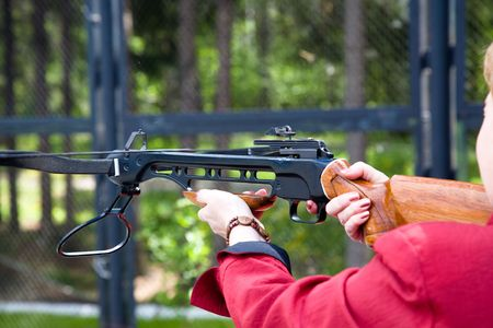 finger on trigger: Woman crossbow shooting
