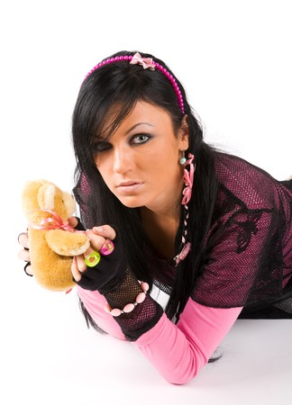 EMO girl posing with  toy bear photo