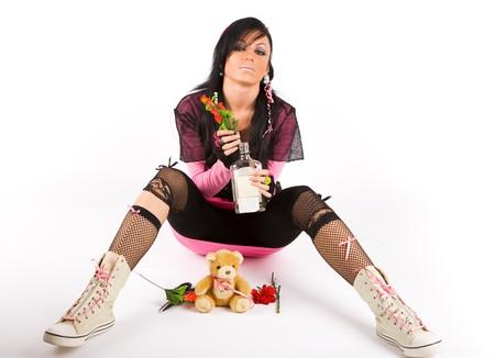 EMO girl with bottle Stock Photo - 3995438