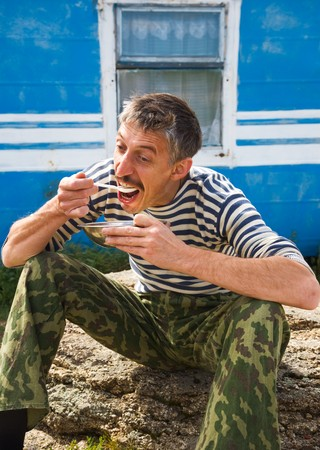 mush: Man eat mush on the nature Stock Photo