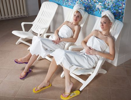 Two young women at the sauna in the spa-center 스톡 콘텐츠
