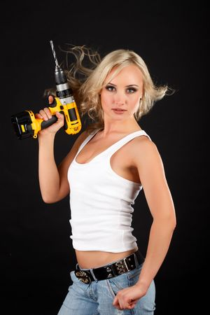 Portrait of blonde with a yellow drill. photo