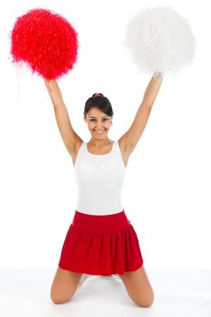 Jonge dame cheerleader poseren in de studio, geïsoleerd op wit