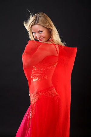 Young blonde belly dancer in red. photo