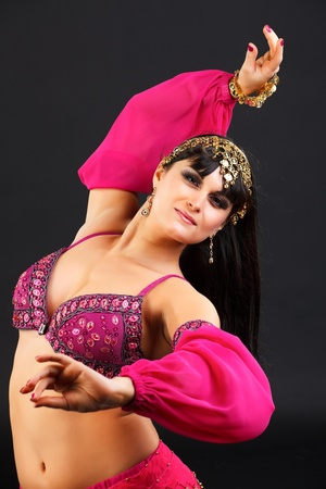 Young blonde belly dancer in pink. photo