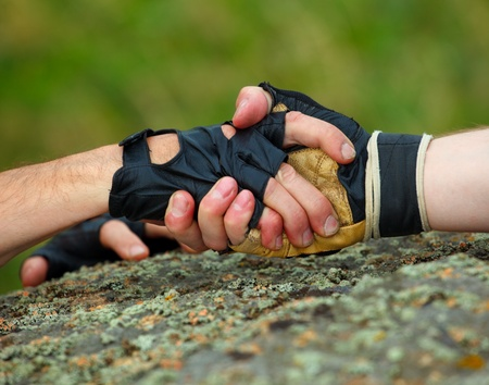 climbing sport: Reliable and strong arm friend. Stock Photo