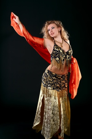 belly dance: Belly dancer.