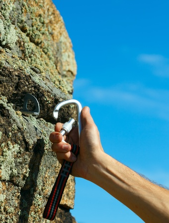 carabiner: Carbine and hook with rope in stone