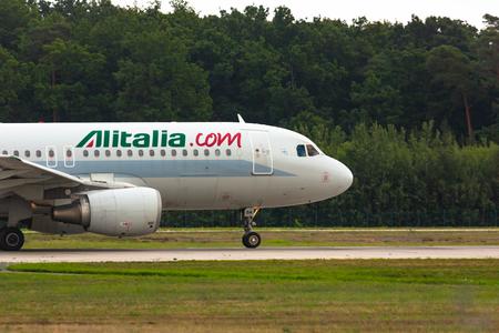 Aircraft Alitalia Airways takes off